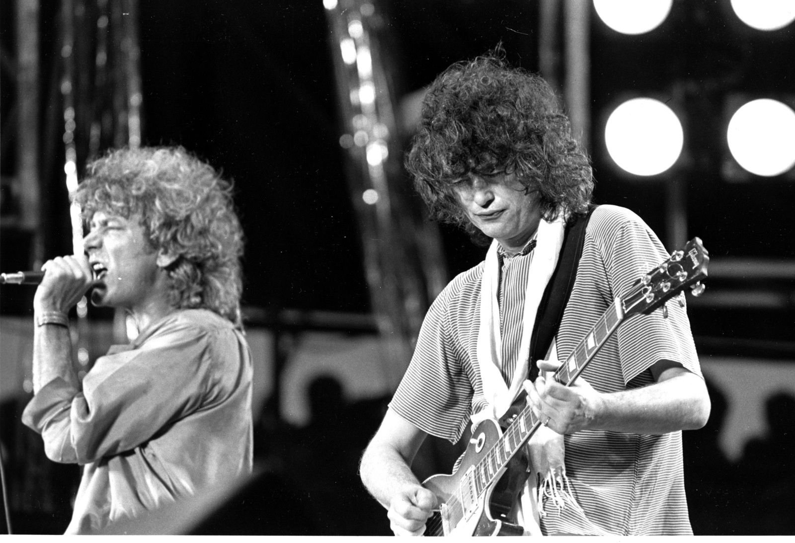 Robert Plant - Led Zeppelin's singer and guitarist Jimmy Page perform during 1985's Live Aid at JFK Stadium in Philadelphia