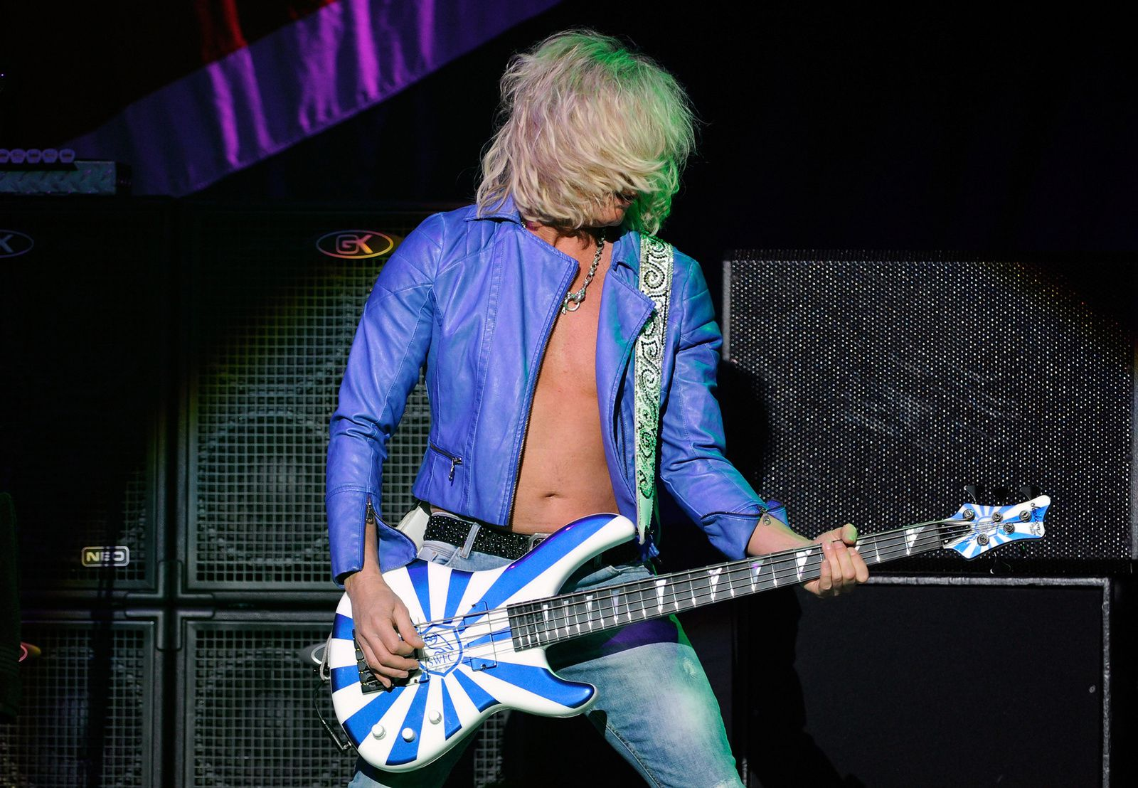 Rick Savage of Def Leppard performs on the opening night of Viva! Hysteria in Las Vegas (2013) - credit: David Becker/Getty Images