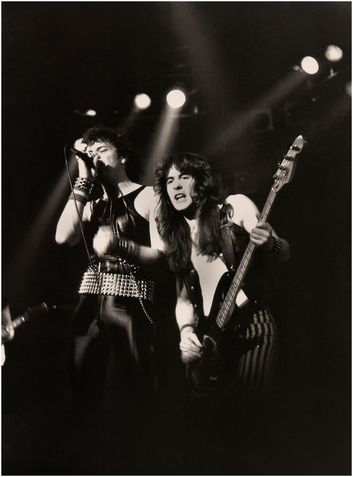 Steve Harris and original vocalist Paul Di'Anno (IRON MAIDEN) -  supporting Judas Priest on their British Steel Tour, Manchester, Apollo (1980)
