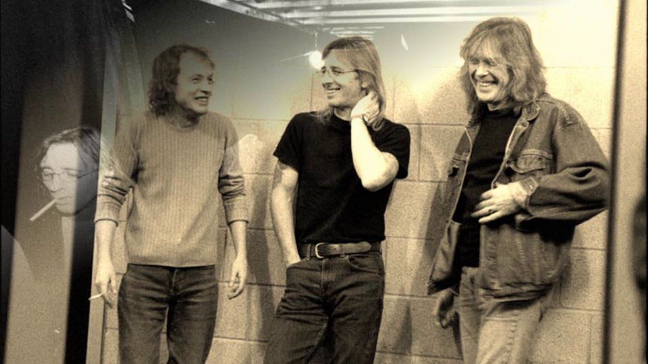 Angus Youg, Phil Rudd and Cliff Williams, AC/DC