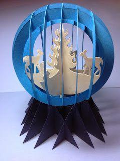 Kirigami boule décors d'hiver