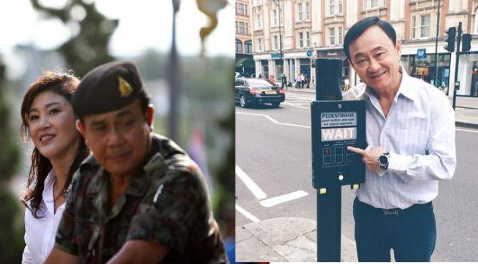 Yingluck posant sur des photos avec Prayuth et Taksin disant d'attendre