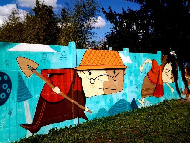 Une belle fresque réalisée devant l école maternelle de Beutre, avec des personnages de contes, Boucle d or, le petit chaperon rouge, Han sel et Gretel...