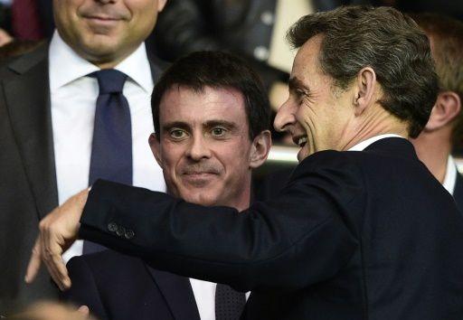 L'ancien président Nicolas Sarkozy (à droite) et le Premier Ministre Manuel Valls à Paris le 15 avril 2015 © Franck Fife