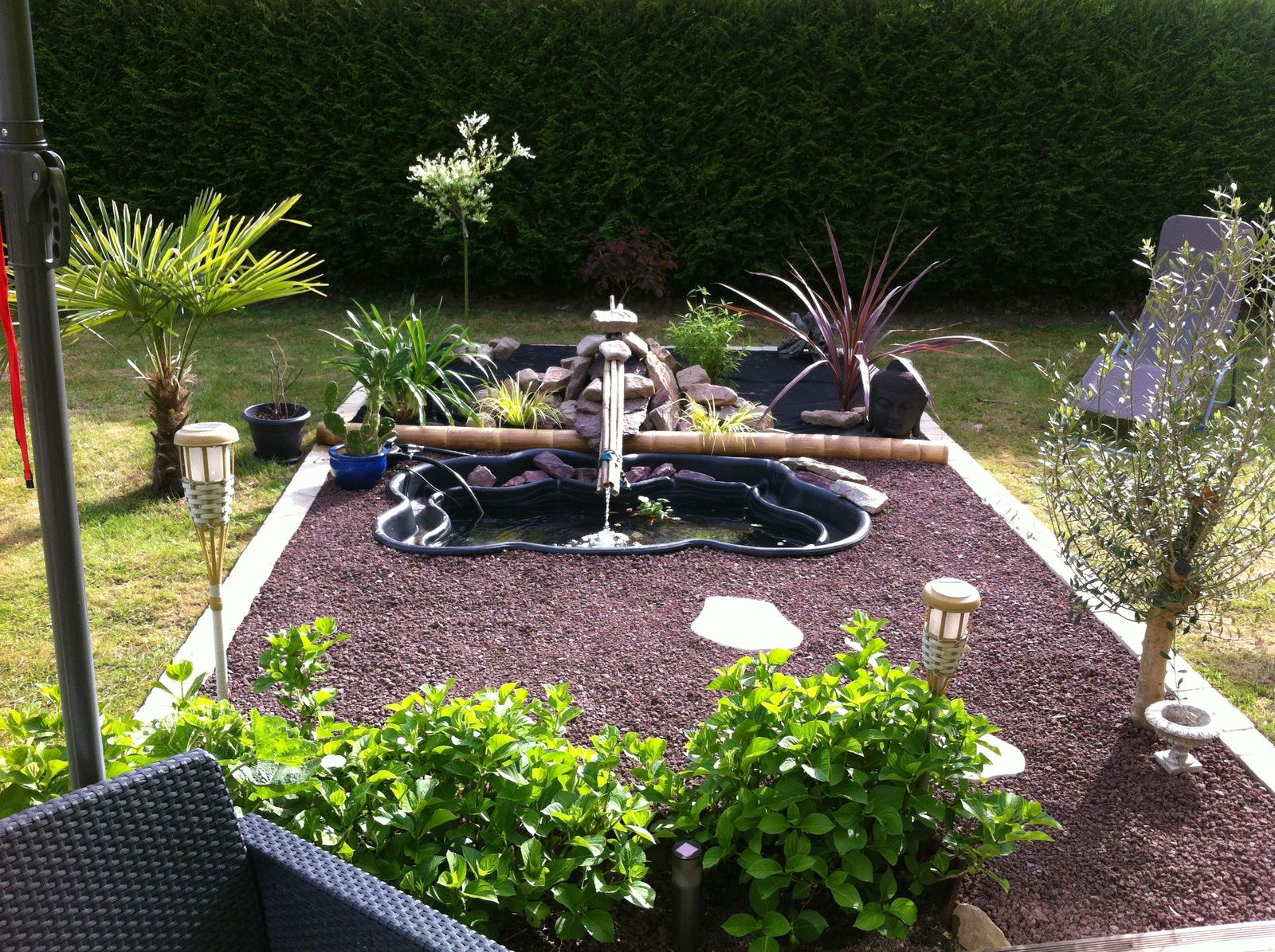 Un bassin de jardin zen voyages plong e vid o for Photo bassin de jardin
