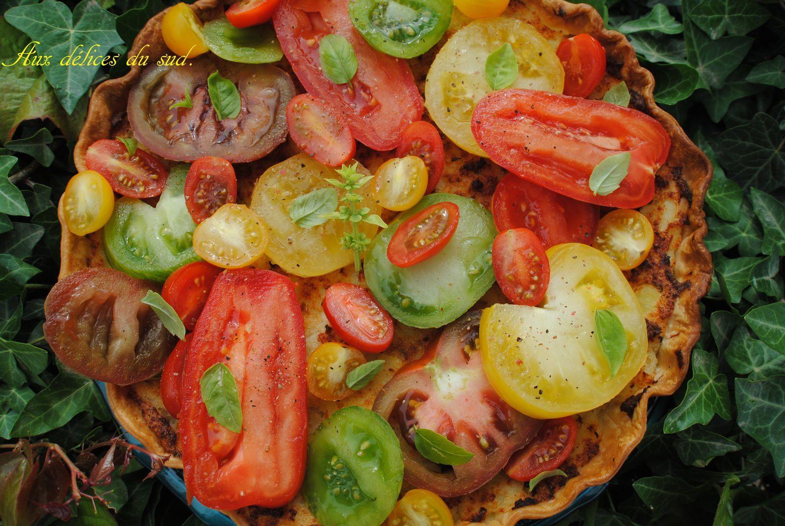 Tarte à la brandade et tomates anciennes .