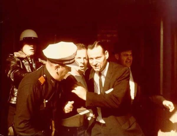 Lee Harvey Oswald is arrested and taken out of the Texas Theater in Dallas, Tex., on Nov. 22, 1963.