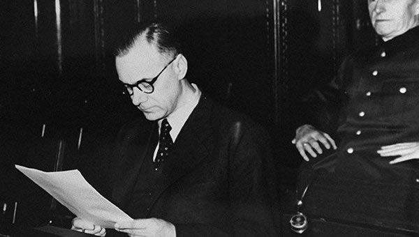 Alfred Rosenberg reads a document during the Nuremberg war crimes tribunal in 1946