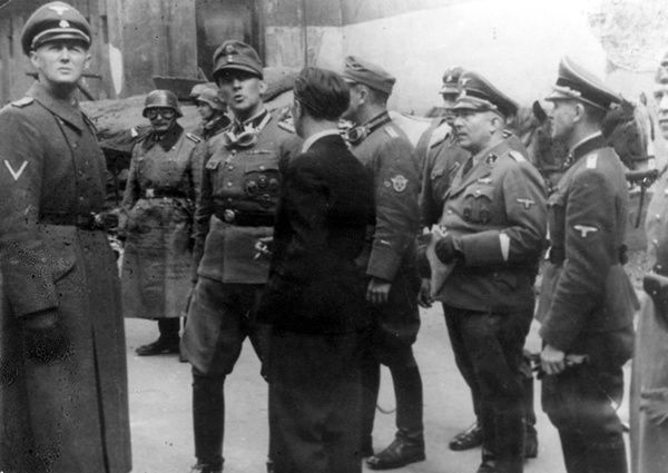 Warsaw, Poland, Jürgen Stroop escorted by SS and police officers, during the suppression of the Ghetto Uprising, April 1943