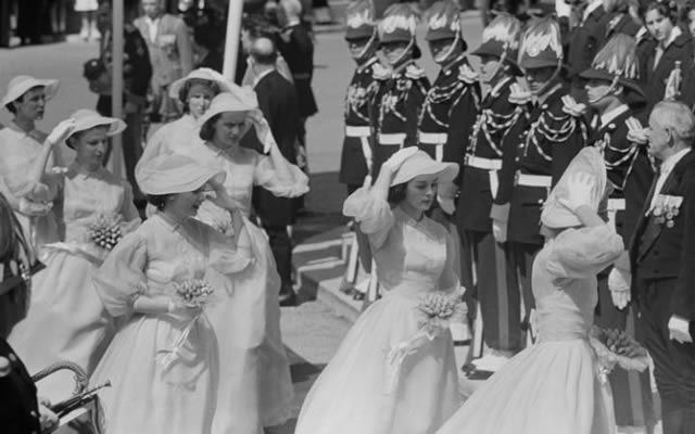 The bridesmaids arriving at Saint Nicholas Cathedral, Monaco, for the wedding of Grace Kelly and Prince Rainier in 1956