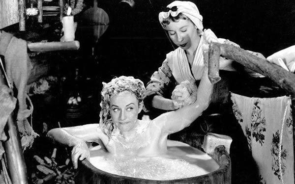 Virginia Campbell giving Paulette Goddard a bath