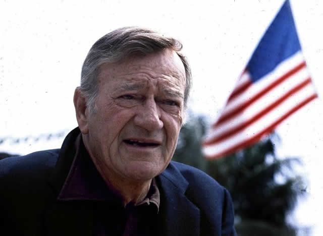 """This 1978 file photo shows actor John Wayne wearing a brown plaid coat he wore in 1945's """"Flame of Barbary Coast."""" Last year, Texas proclaimed May 26, Wayne's birthday, as """"John Wayne Day"""" but on Thursday, the California Assembly refused to do the same"""