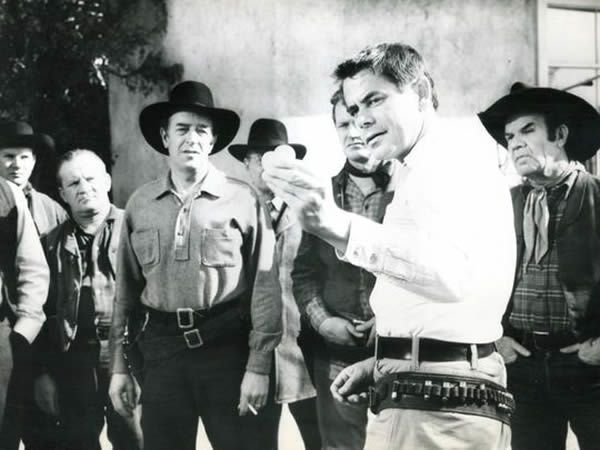 Glenn Ford demonstrates his shooting in 'The Fastest Gun Alive'