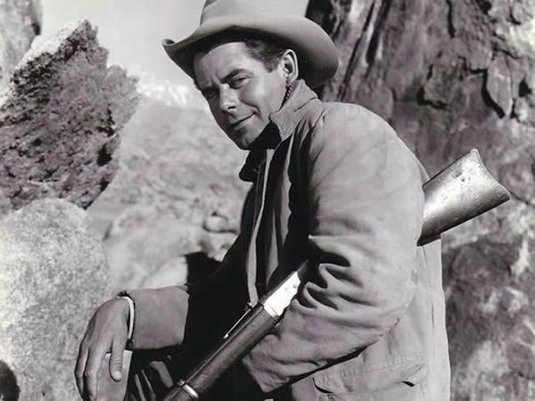 Glenn Ford in publicity shot as cowboy