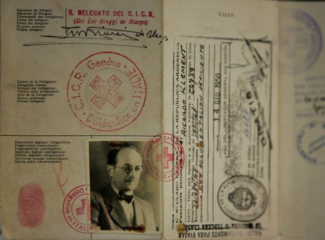 """The aging cardboard passport used by Adolf Eichmann, a high-ranking Nazi who escaped to Argentina after World War II, is shown in Buenos Aires, Argentina,Tuesday, May 29, 2007, after it has been recovered from musty court files here by a judge. Eichmann, one of the leaders of a campaign of mass deportation of Jews to extermination camps in Nazi-occupied Eastern Europe during the war, fled to Argentina in 1950 under the alias as """"Ricardo Klement."""" with a passport issued by the Red Cross. Abducted by Israeli agents in 1960 from a Buenos Aires suburb, he was taken to Israel, tried for crimes against humanity and then hanged in 1962"""