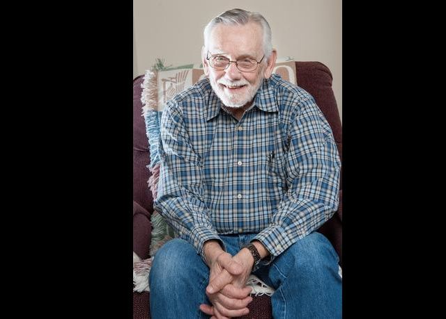 Herman Schneider talks about witnessing the Nuremberg trials during World War II while at his home Friday in Rantoul