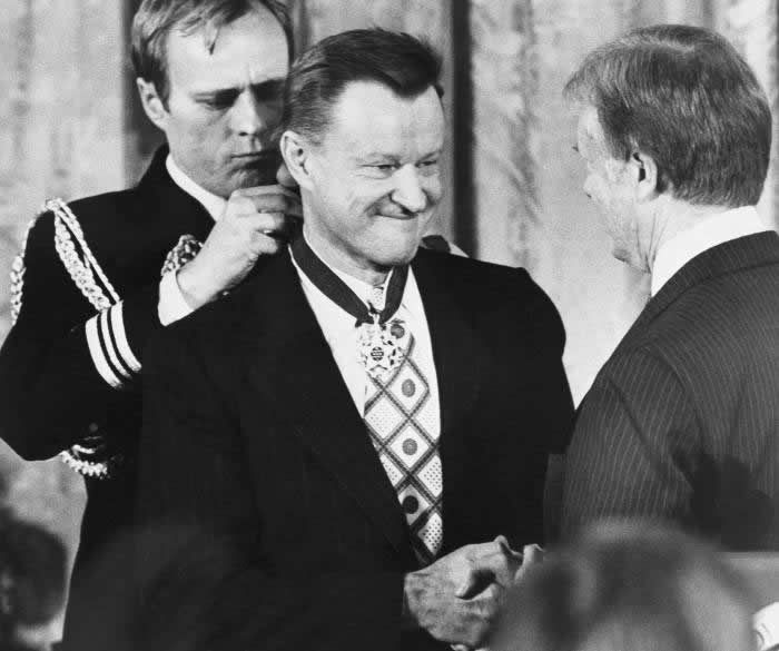 President Jimmy Carter presents Brzezinski with the Medal of Freedom at a White House ceremony in Washington on January 17 1981 © AP