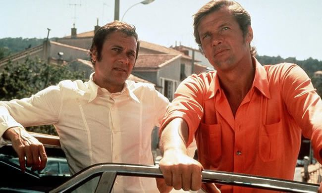 Roger Moore as the dapper Lord Brett Sinclair, with Tony Curtis as the ruffian Danny Wilde in The Persuaders! Photograph: Allstar/ITC