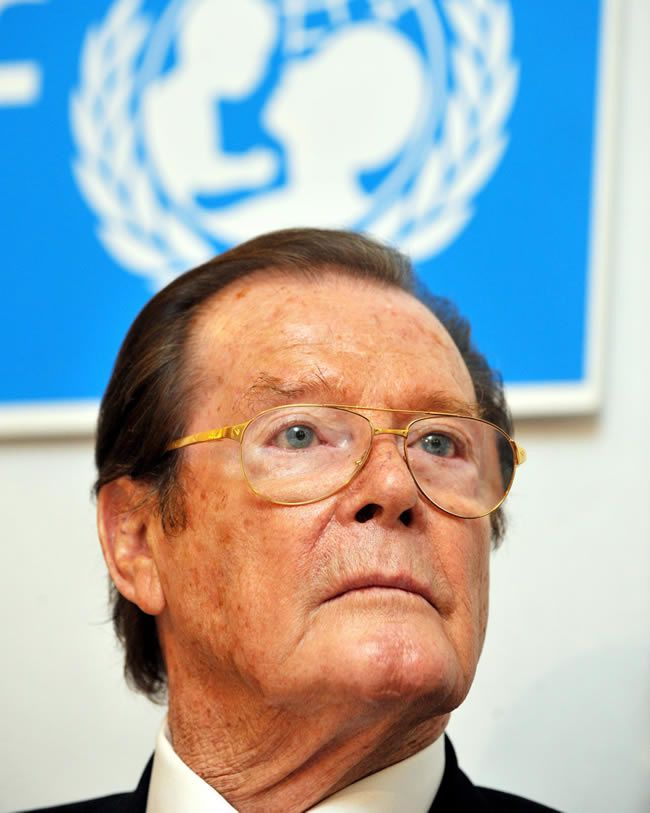 Roger Moore during a Unicef press conference in Germany, 2010. He served as a goodwill ambassador and was knighted for his humanitarian work. Photograph: Patrick Seeger/EPA