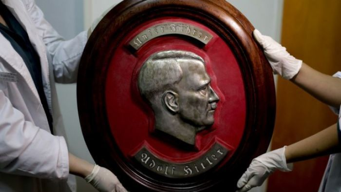 Members of the federal police show a bust relief portrait of Nazi leader Adolf Hitler at the Interpol headquarters in Buenos Aires, Argentina, June 16, 2017.