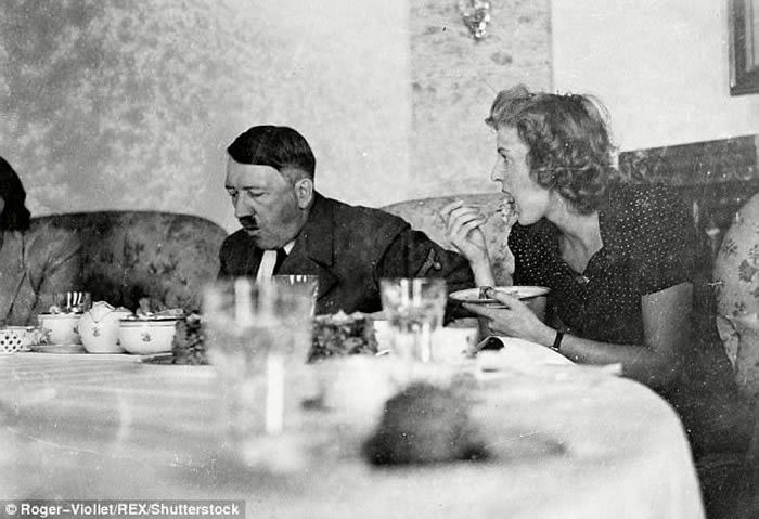 Needs of the Fuhrer: Hitler is seen having                         tea with his mistress Eva Braun at the Berghof,                         Berchtesgaden, where a young Constanze Manziarly                         became his personal chef