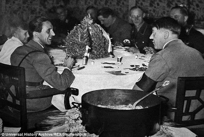 Picky eater: Adolf Hitler, seen sat down                         for a meal with Josef Goebbels, was a demanding                         diner who preferred to eat millet and quark with                         linseed oil