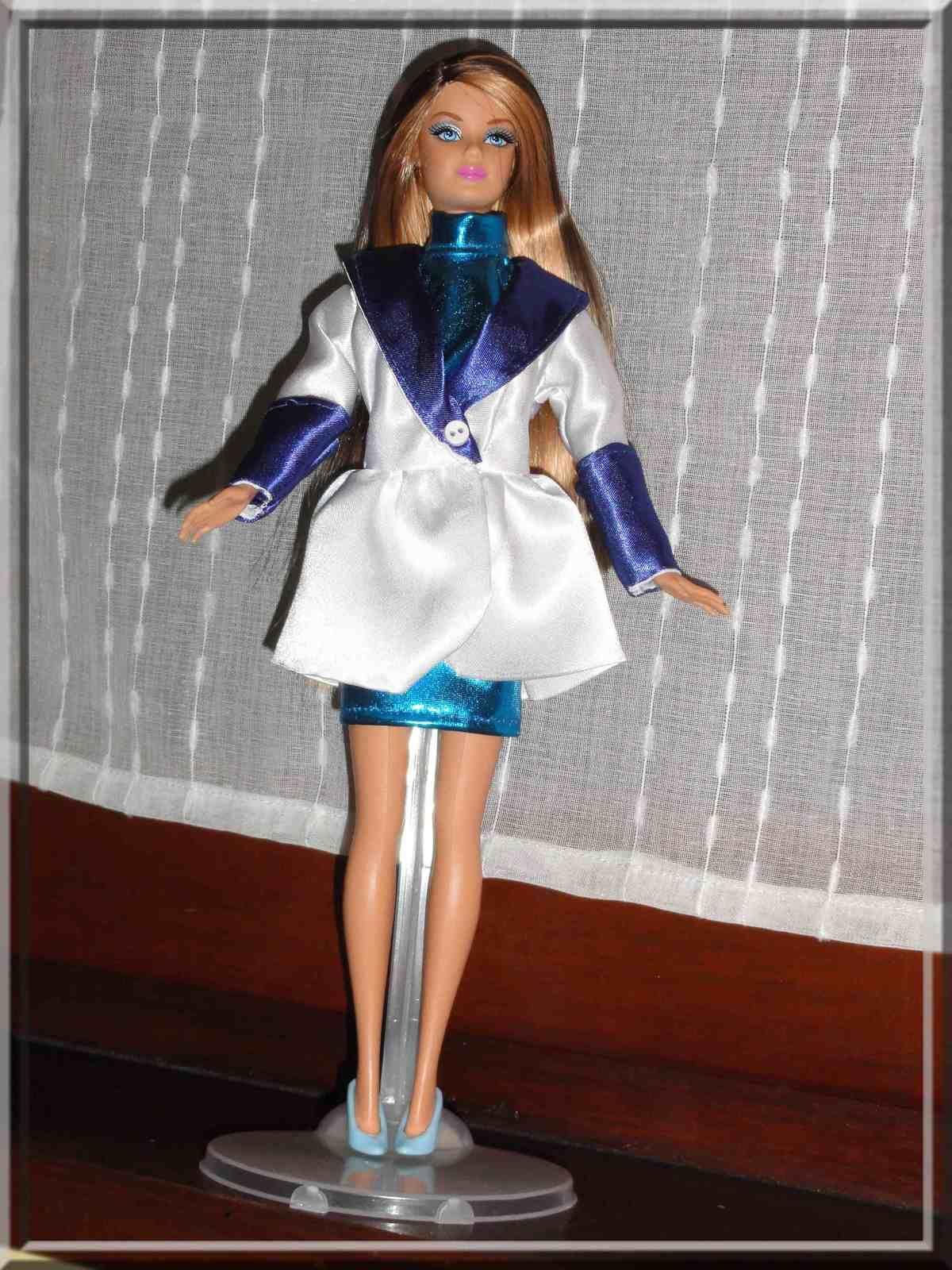 Robe en lamé turquoise et une petite veste assortie