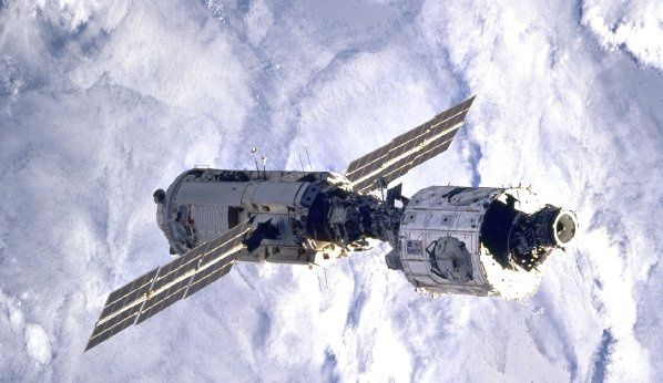 Photograph of the Zaria and Unity modules on orbit, connected by a Pressurized Mating Adapter (PMA) (NASA)