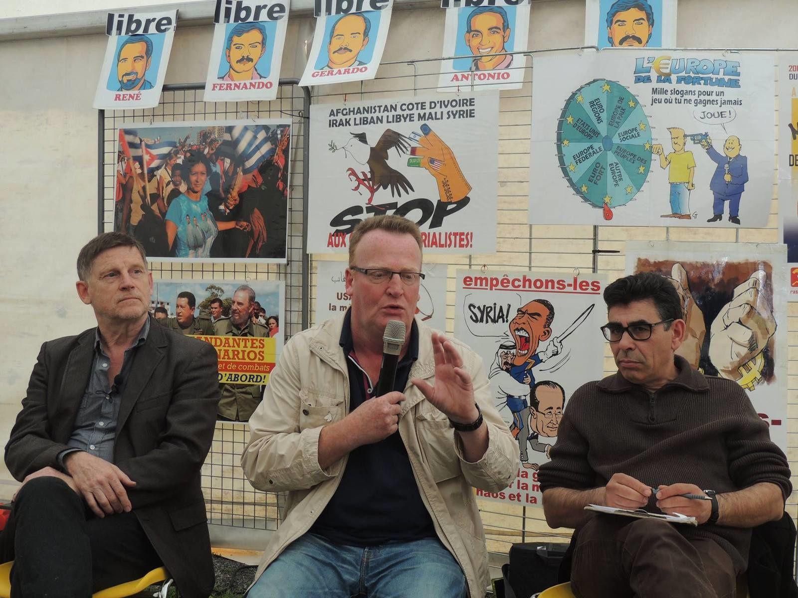 En 2015 lors d'un débat à la fête départemental du PCF à Avion. de gauche à droite Michel Collon, Hervé Poly et Saïd Un film de Michel Collon & Denise Vindevogel. (Belgique, 2014) .