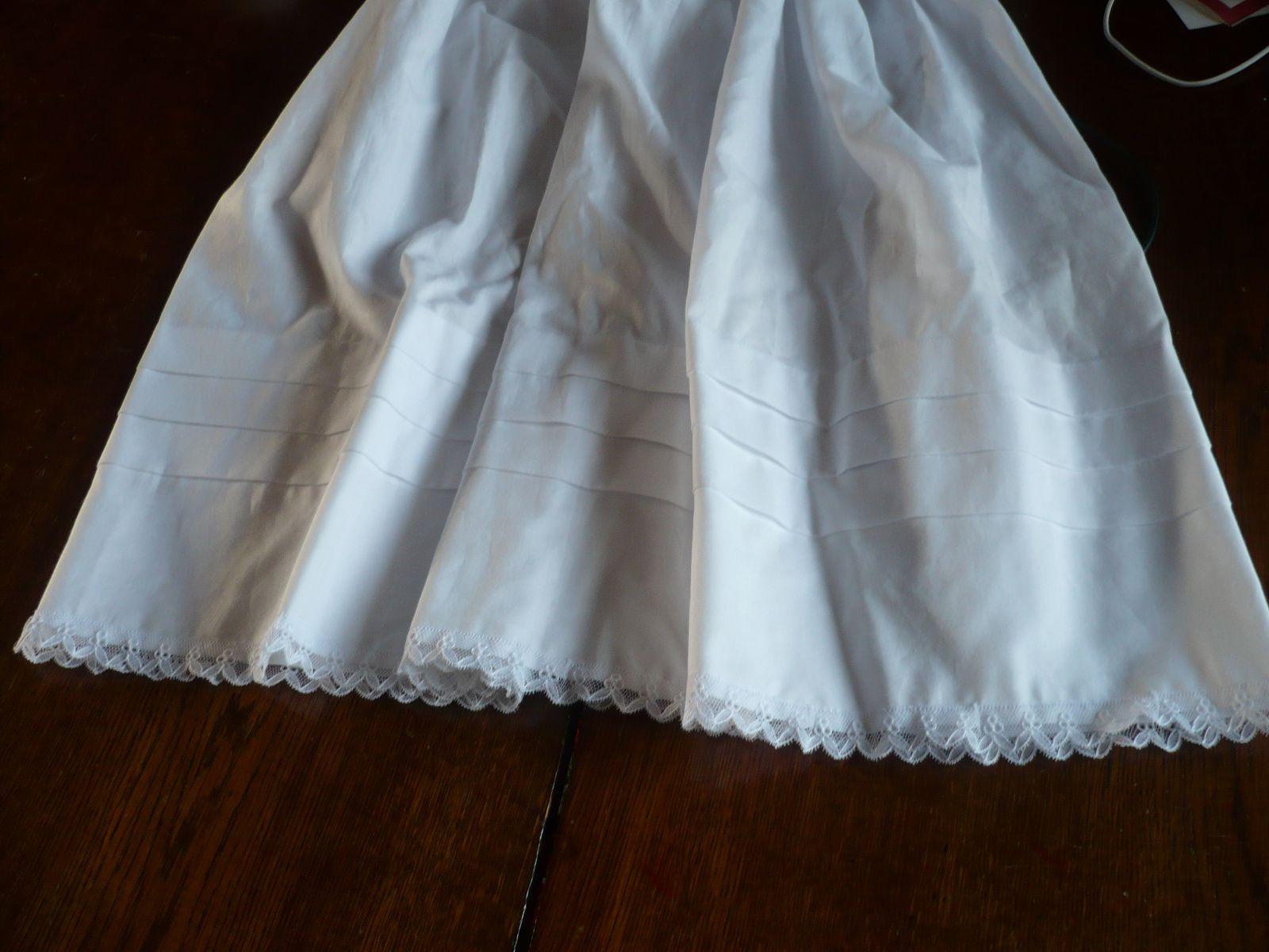 la partie jupe de ma robe de baptême