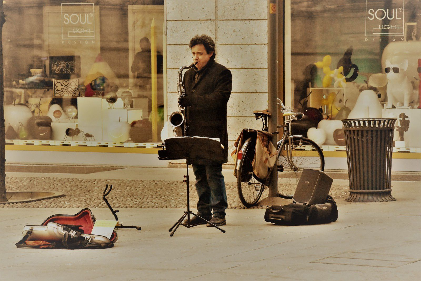 A SAXMAN ALONE IN THE STREET IN MILAN TOWN