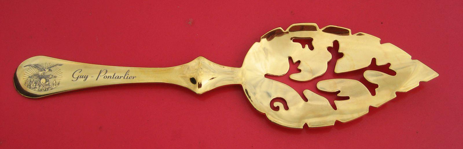 Inox et vermeil (tirage limité). A noter le logo de la Maison représentant l'aigle survolant les sapins. Guy-Pontarlier.