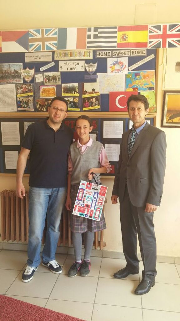 Here's a photo of Tuğçe  receiving her prize with Mr Tezcan and the Headmaster of the school..
