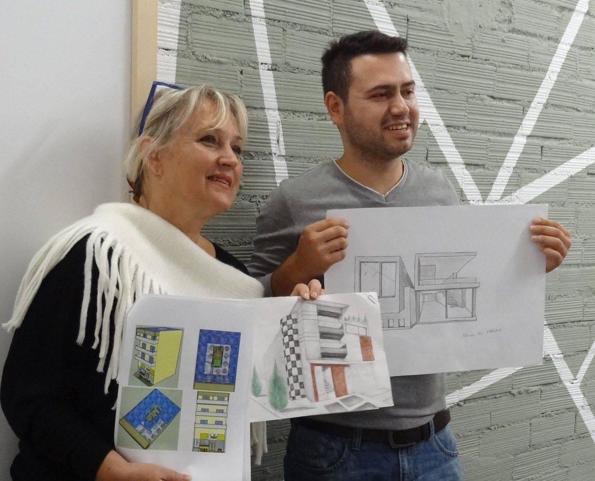The teachers in A Coruña during the Transnational Meeting voting for the best work. Areti from Greece and Burak from Turkey proudly showing the works of their students while Maria José and Silvia were desperate because no Spanish student has won a competition yet &#x3B;)