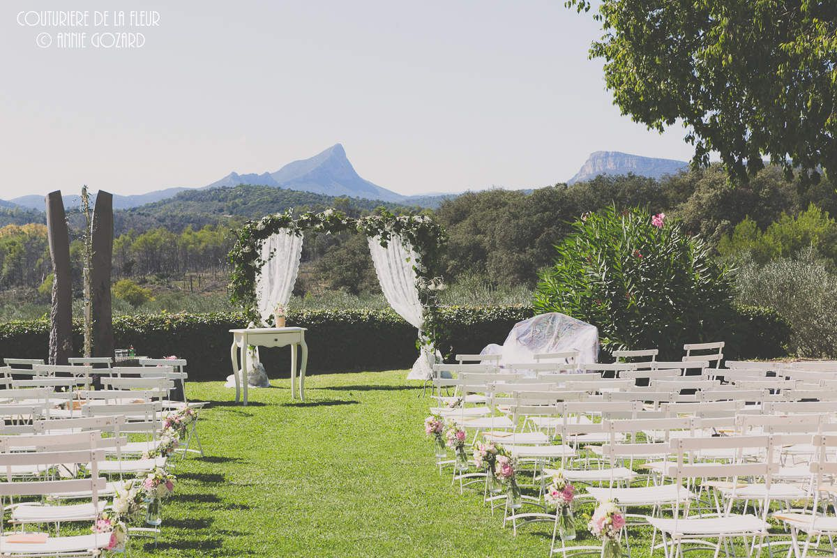 Ceremony, with ark and vintage chairs decorated with old pink and white flowers