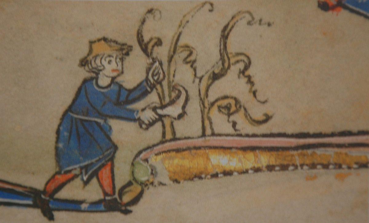 Le voici avec sa serpe pour une récolte.