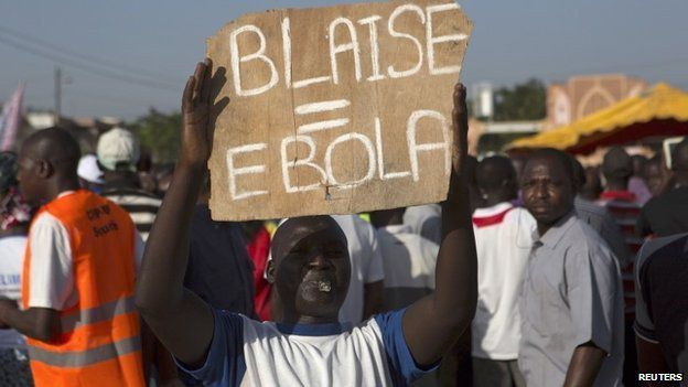 A protester comparing Compaore to Ebola