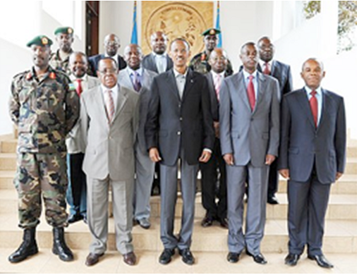 Rwandan Defense Minister General James Kabarebe, front row, second from right, General Paul Kagame in the middle with the Congolese Minister of Defense and the Army Chief of Staff, in Kigali in May 2014.  1998, General Kabarebe launched a failed attack on Kinshasa, through Kitona, more than 2000 miles from Kigali, Rwanda.