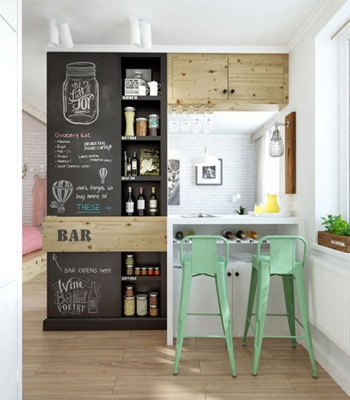 The white kitchen with some (Scandinavian) touches of colors and a great counter for breakfast and...bottles!