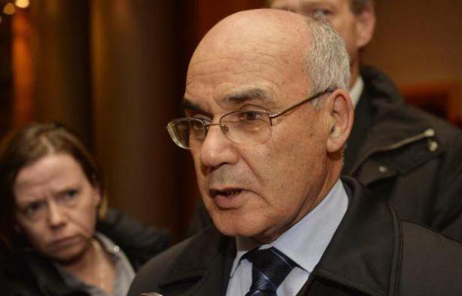 Le Ministre algérien de l'Energie Youcef Yousfi arrive à une réunion de l'OPEP