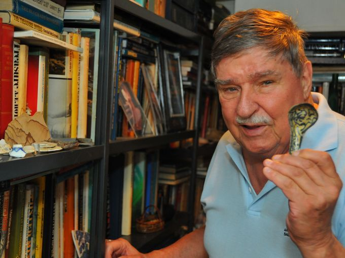 Robert Marx holds a soup spoon, found off the coast south of Sebastian Inlet, recovered from Capitana wreck. (Photo: MALCOLM DENEMARK/FLORIDA TODAY)