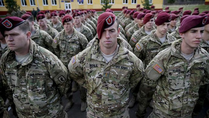 """Servicemen of the 173rd Airborne Brigade Combat Team of the U.S. Army attend an opening ceremony of joint military exercise """"Fearless Guardian 2015"""" at the International Peacekeeping Security Center near the village of Starychy western Ukraine, April 20, 2015.(Reuters / Gleb Garanich)"""