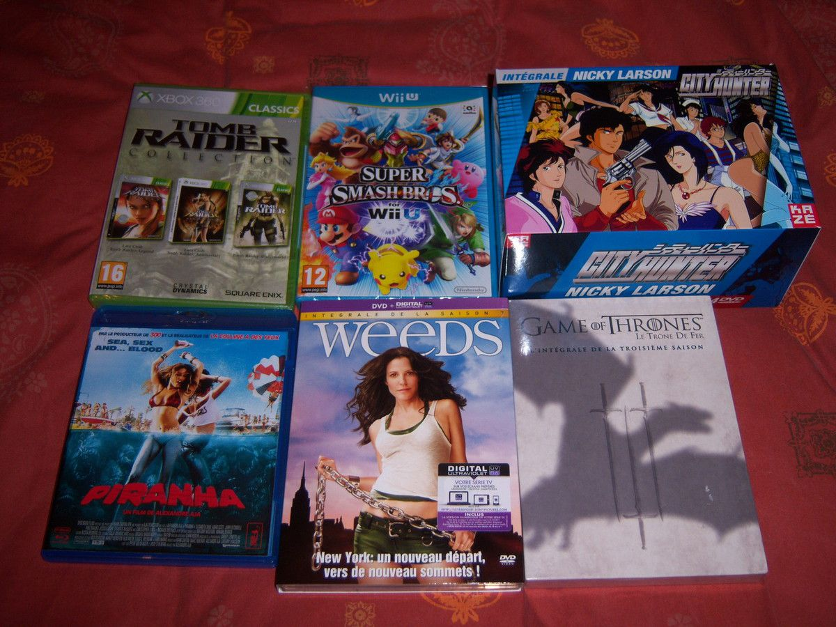 Tomb Raider trilogy (XBOX360), Super Smash Bros. WiiU, City Hunter - Nicky Larson - Intégrale VO/VF non censurée, Piranha BluRay, Weeds saison 7 (DVD) et Game of thrones saison 3 en DVD.