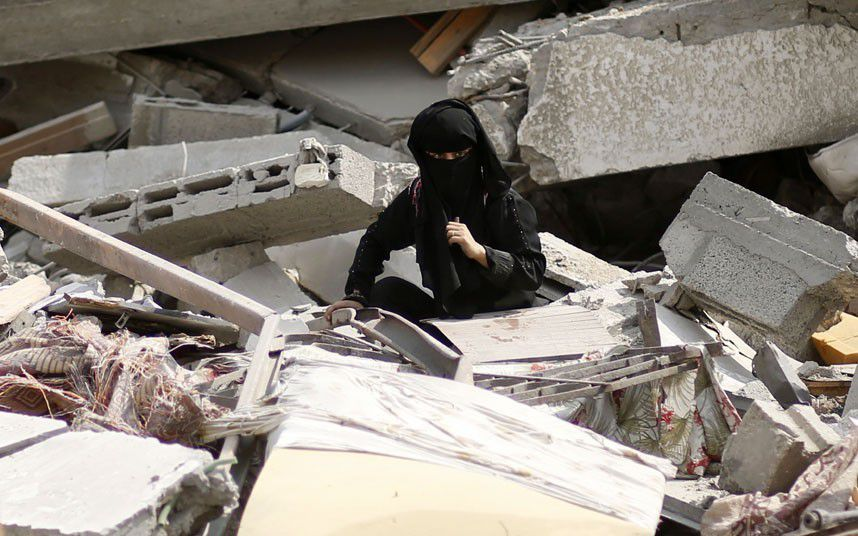 Gaza Under Attack : A Palestinian woman searches for her belongings