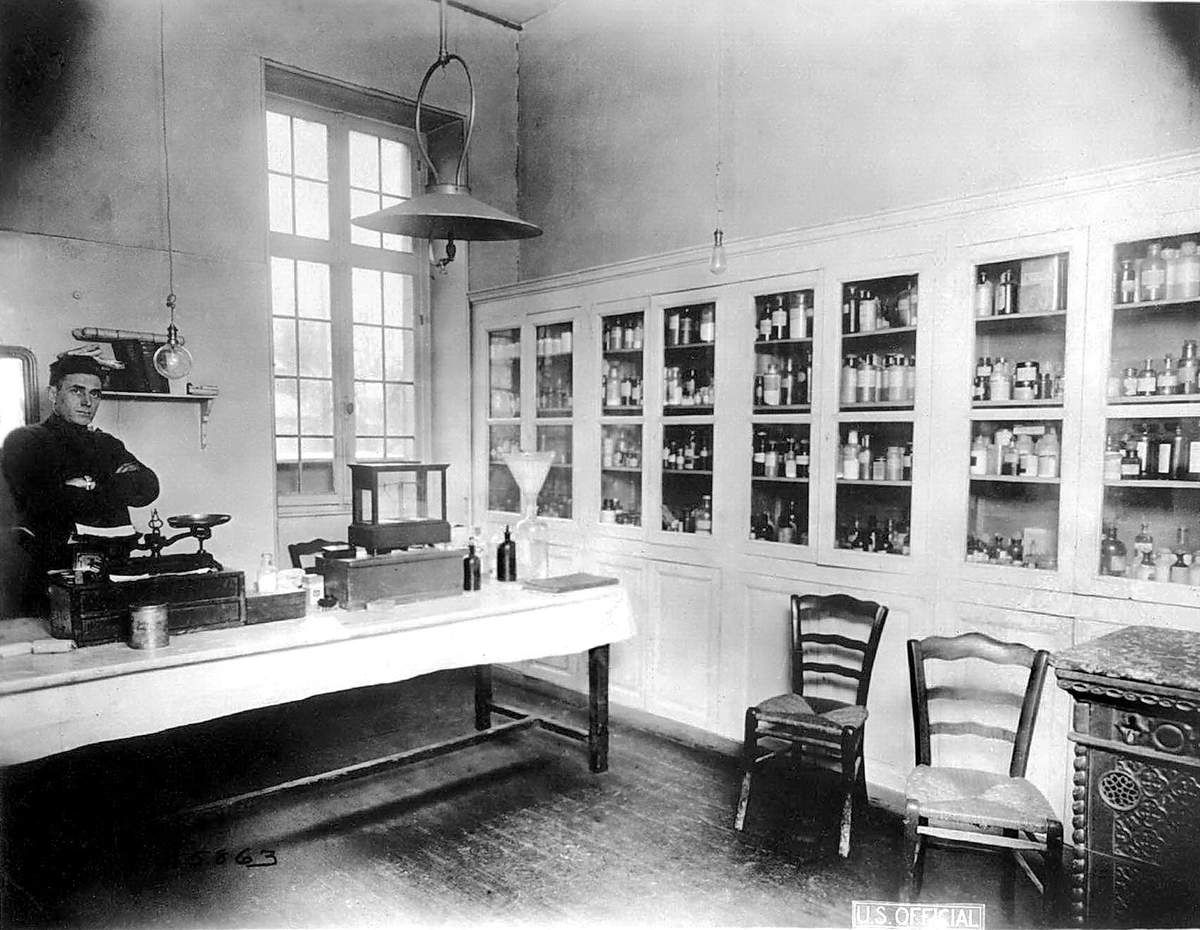 Dispensary or Pharmacy, Camp Hospital 28, Nevers, December 28, 1918 - Description: Charles Taylor standing in the dispensary.