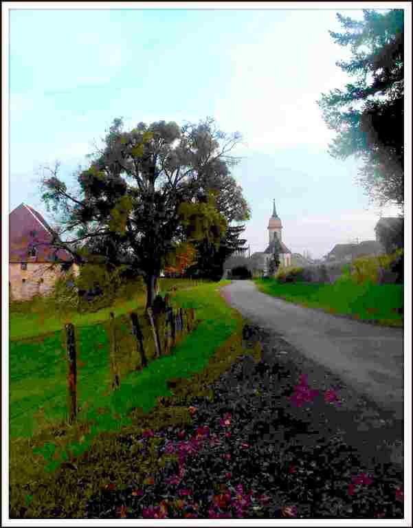 Evans Jura - Entrée du village - Le chateau et l'église