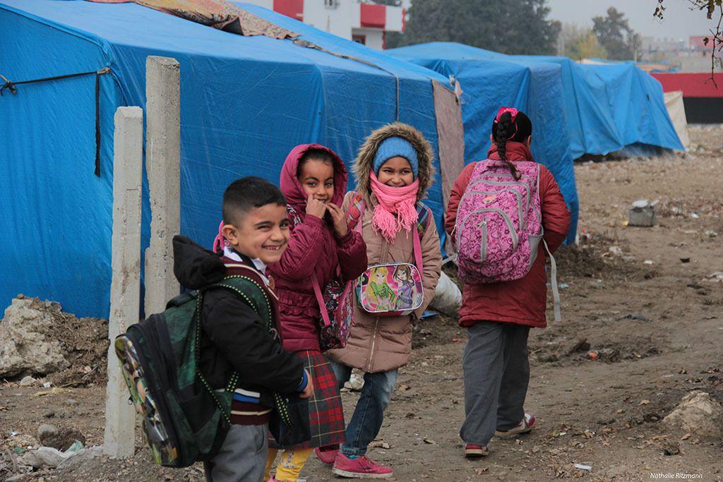 Retour au camp de réfugiés d'Adana