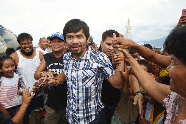 Les sondages montrent qu'Emmanuel «Manny» Pacquiao est quasiment assuré d'enlever un des 12 sièges de sénateurs (sur 24) qui seront à pourvoir le 9 mai. PHOTO TED ALJIBE, AFP