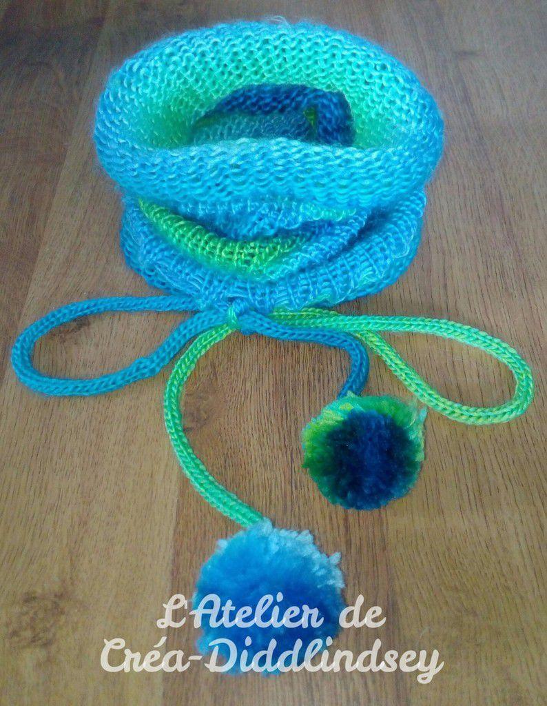 Une écharpe type snood utilisable en bonnet ou cagoule réaliser au tricotin Prym