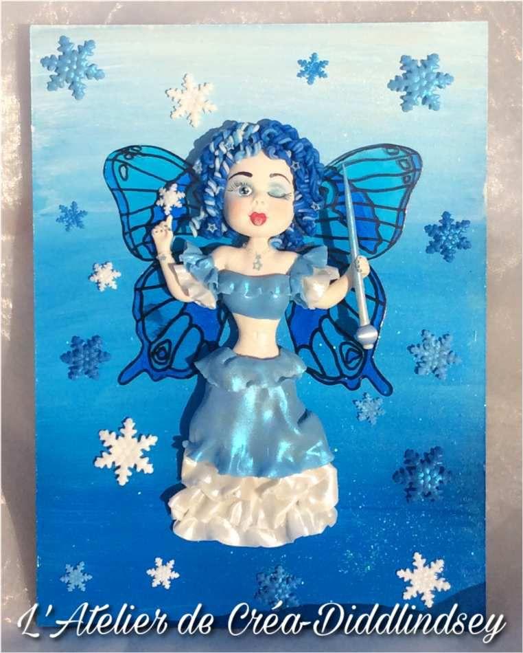 Tableau 3d une jolie fée des glaces et deux Livert est en porcelaine froide Brazil biscuits